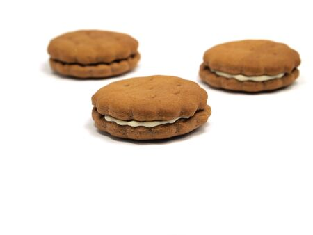sandwitch: Chocolate sandwitch biscuits with cream filling on a white background Stock Photo