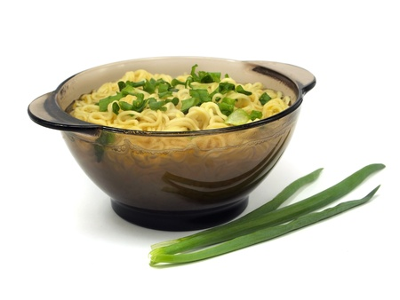 Instant noodles in bowl on a white background  photo