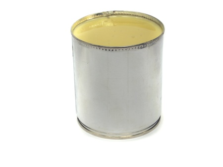 can of condensed milk on white background