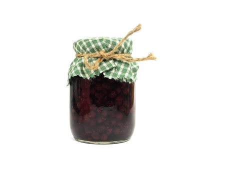 strawberry jam in glass jar on white background   photo