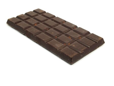 Chocolate bar with hazelnut on a white background     photo