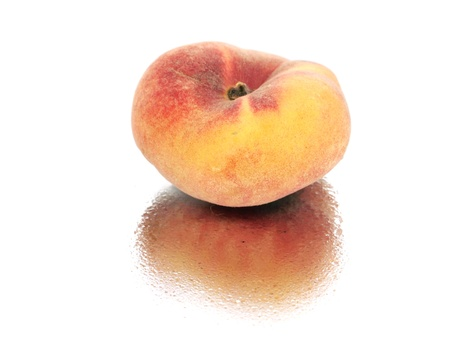 Exotic flat peach on a white background with water drop  photo