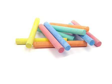 white chalks: chalks in a variety of colours arranged on a white background