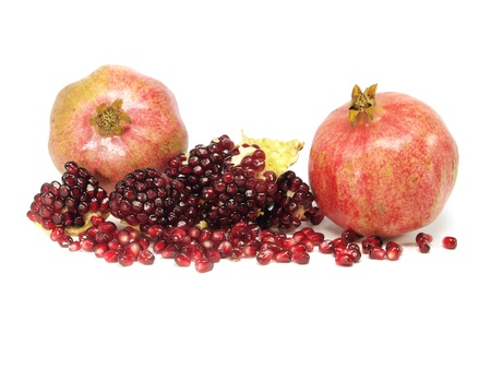 peal: fresh pomegranate on a white background      Stock Photo
