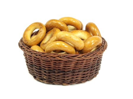 Ring bagels in basket on a white background     photo