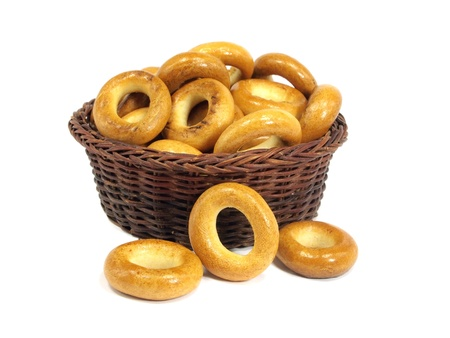 boublik: Ring bagels in basket on a white background     Stock Photo