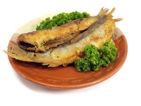fried small smelt fish on white background   Stock Photo