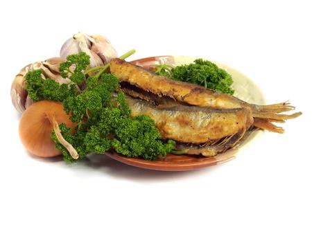 smelt: fried small smelt fish on white background   Stock Photo