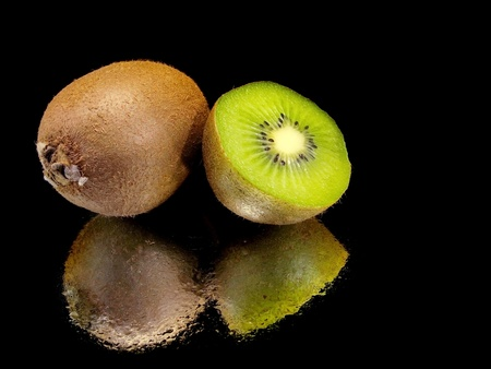 kiwi fruits on a black background with water drops