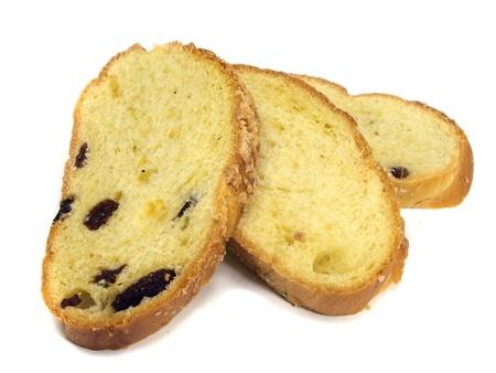 Sweet bread plait with raisins on a white background     photo
