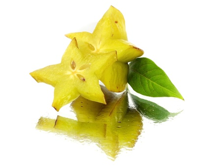 carambola - starfruit on a white background with water drops   photo