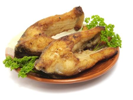 fried crucian carp on a white background   photo