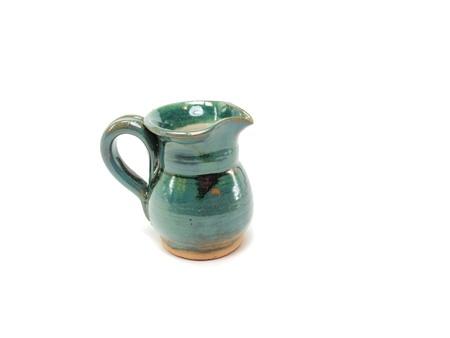 robustness: ceramic jug on a white background       Stock Photo