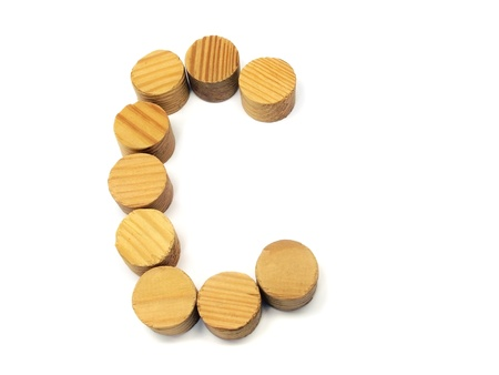 wood building blocks letter C on a white background   photo