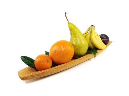 fruit in wooden plate on white background Stock Photo - 13394283