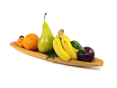 fruit in wooden plate on white background Stock Photo - 13394280