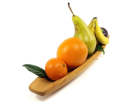 fruit in wooden plate on white background photo