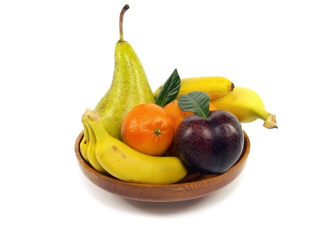 fruit in wooden plate on white background Stock Photo - 13394410
