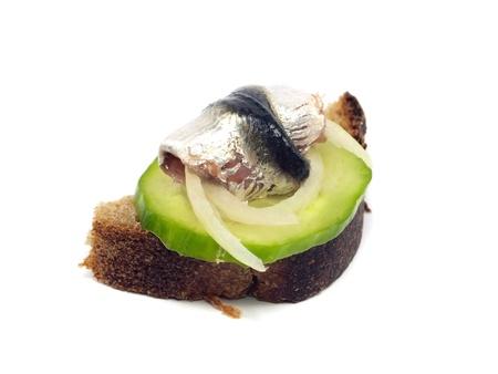 sprat: sandwich with marinated sprat on a white background
