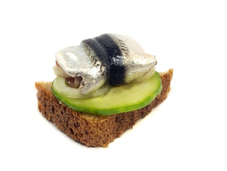 sandwich with marinated sprat on a white background         photo