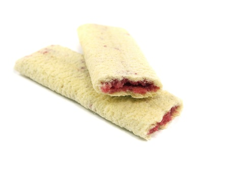 teaparty: Cookies with a jam stuffing on a white background