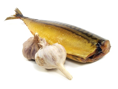 Smoked Mackerel with garlic bulb on a white background   photo