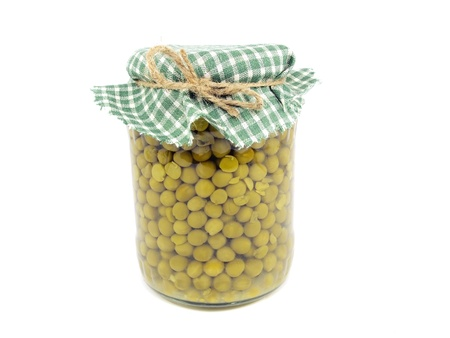 canned green peas in glass jar on a white background    photo