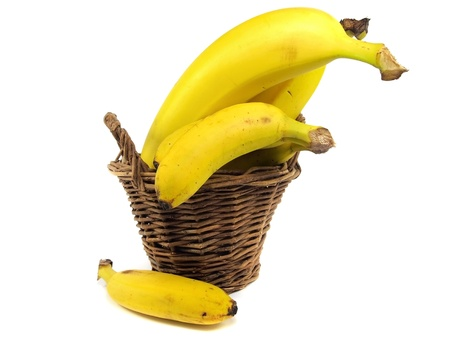bananas in basket on a white background photo