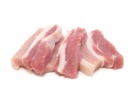 uncooked bacon: Pork belly on a white background