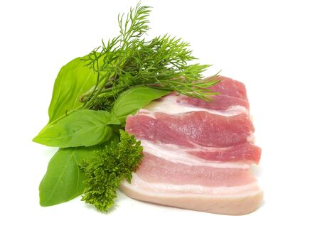 streaky: Pork belly with herbs spices on a white background         Stock Photo