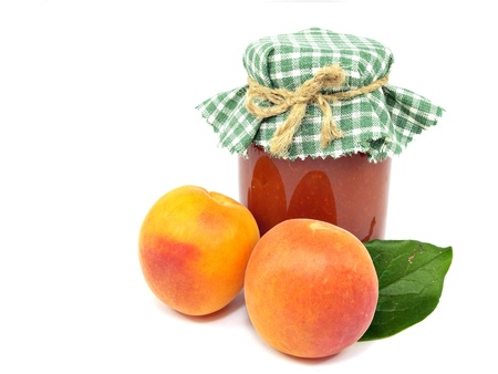 Apricot jam on a white background   photo