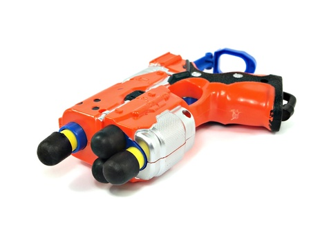 orange toy dart gun on a white background