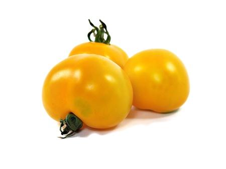 yellow organic tomatoes on a white background     photo