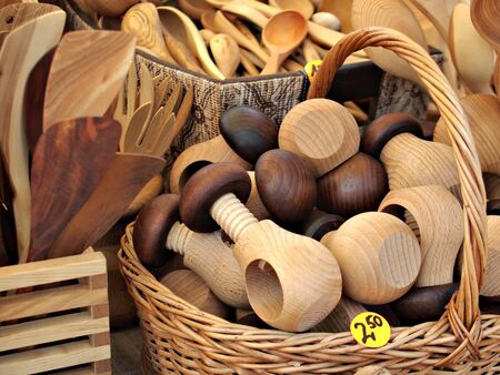 various kinds of wooden kitchen tools at the market photo