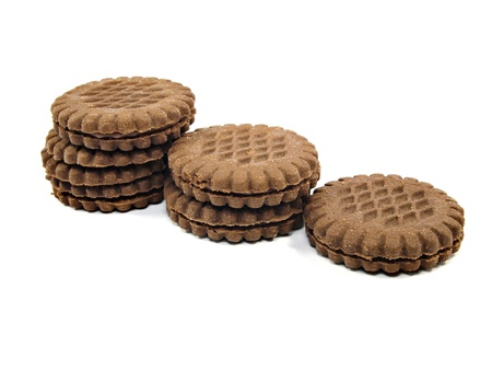 brown chocolate sandwich biscuits with cream filling on a white background        photo
