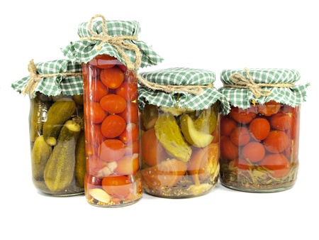 pickled cucumbers and tomatoes canned in glass jar on a white background      photo