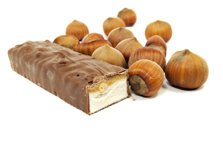 chocolate with nuts on a white background       photo