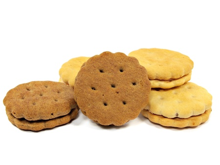 biscuit: sandwich biscuits with cream and chocolate fillings on a white background