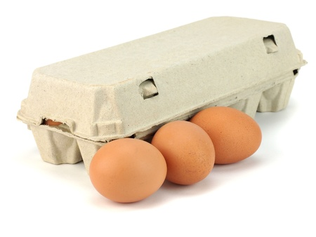 carton: Eggs in paper box on a white background