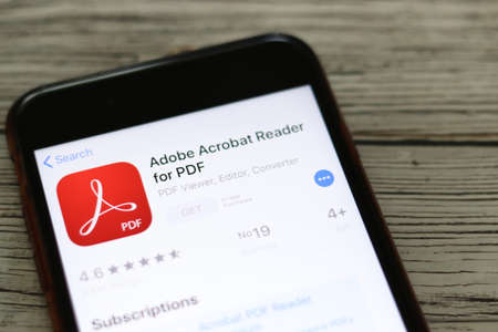 Phone with Adobe Acrobat Reader logo on screen top view close-up. Los Angeles, California, USA - 9 November 2019, Illustrative Editorial. 報道画像