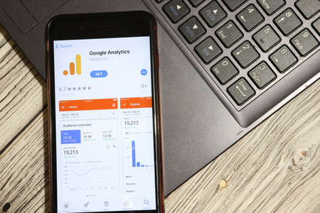 Los Angeles, California, USA - 3 December 2019: Google Analytics App Logo on phone screen with laptop flat lay, Illustrative Editorial.