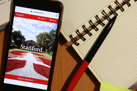 Los Angeles, California, USA - 7 December 2019: Phone screen with Stanford University website page top view. Higher education admission concept, Illustrative Editorial.