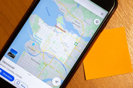 Map of Vancouver city on phone screen close-up top view with copy space.