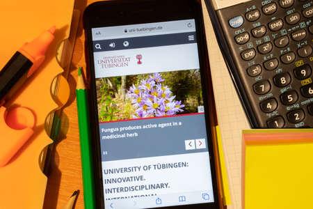 Saint-Petersburg, Russia - 10 January 2020: Phone screen with Eberhard Karls Universitat Tubingen website page. Higher education admission concept, Illustrative Editorial.