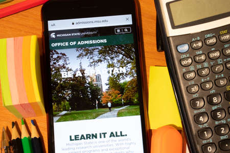 Saint-Petersburg, Russia - 10 January 2020: Phone screen with Michigan State University website page. Higher education admission concept, Illustrative Editorial. Editorial