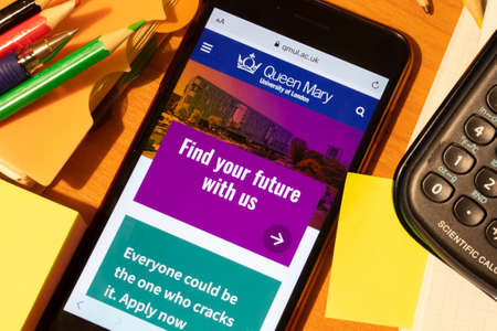 Saint-Petersburg, Russia - 10 January 2020: Phone screen with Queen Mary University of London website page. Higher education admission concept, Illustrative Editorial.