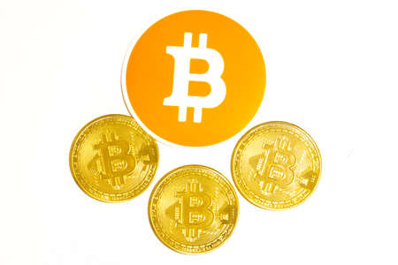 Bitcoin and cryptocurrency coins on white background.