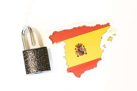 Spain national flag with outline on white background with open lock top view. The concept of opening the borders of the country. Stock Photo