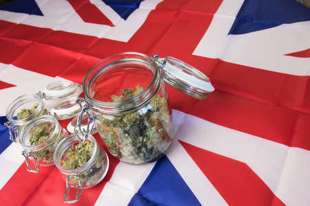 UK flag and medical marijuana with THC. Law status of cannabis.