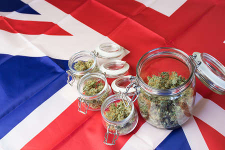UK flag with cannabis top view with copy space.